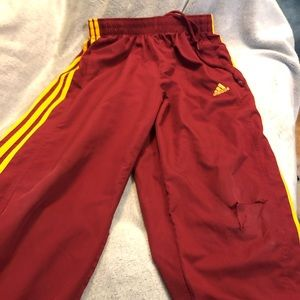 Nike maroon colored boys athletic pants, zippers